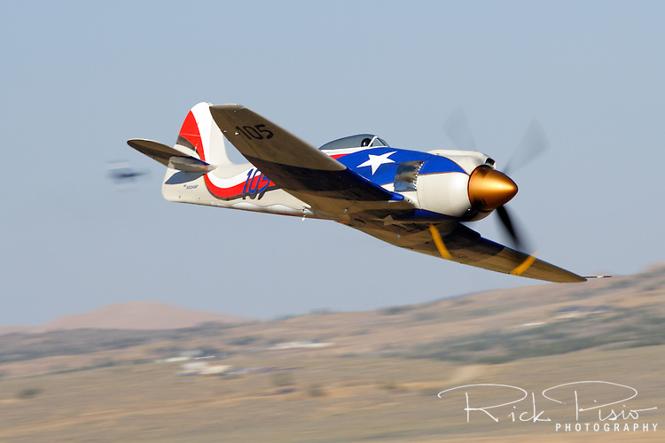 Owned and piloted by Stewart Dawson, Spirit of Texas-Race 105, races through the Valley of Speed during the 2006 Reno Championship Air Races. Stewart piloted the Hawker Sea Fury to a fifth place finish with a speed of 428.759  mph around the 67.29 mile course in the Gold Unlimited Championship race. Photographed 09/06