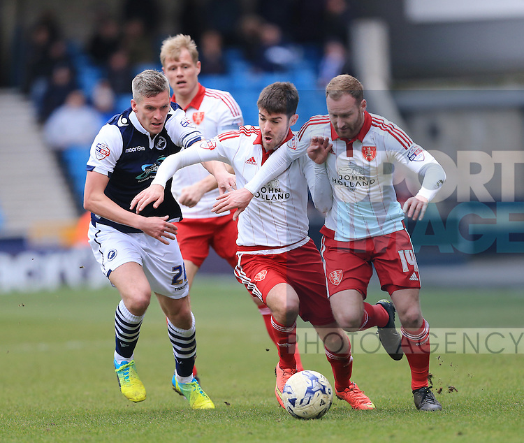 Millwall's Steve Morison tussles with Sheffield United's Ryan Flynn and Matt Done during the League One match at The Den.  Photo credit should read: David Klein/Sportimage