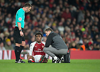 Alex Iwobi of Arsenal sits on the ground injured during the Premier League match between Arsenal and Newcastle United at the Emirates Stadium, London, England on 16 December 2017. Photo by Vince  Mignott / PRiME Media Images.