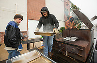 NWA Democrat-Gazette/BEN GOFF @NWABENGOFF<br /> Cameron Grimes (from left), Cody Wynne and Joe Parsley of Rogers cook ham and green beans Thursday, Nov. 28, 2019, during the annual Thanksgiving meal distribution at the First Baptist Church Olive Street campus in Rogers. Wynne said that he takes the cooker to charity events and dissaster relief efforts. <br /> <br /> Paul Olinger, a church member who helped coordinate the meal, said the event started 20 years ago 'As an outreach of the church to show the love of Christ in the community'. Volunteers from the church and the community cooked, packaged and delivered boxed meals that included ham, green beans, mashed potatoes and deserts. <br /> <br /> Open to anyone, a line wrapped around the room as families picked up boxes of food to take home, but Olinger estimates that 98 percent of the meals are delivered by volunteers.
