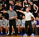 Alton Marquette coach Steve Medford yells in to his team. Alton Marquette played Roxana in the Class 2A Roxana boys basketball regional final at Roxana High School in Roxana, Illinois on Friday February 28, 2020. <br /> Tim Vizer/Special to STLhighschoolsports.com