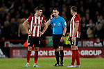 John Egan and Jack O'Connell of Sheffield United wait as referee Stuart Attwell is in contact with VAR during the Premier League match at Bramall Lane, Sheffield. Picture date: 5th December 2019. Picture credit should read: James Wilson/Sportimage