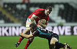 Andrew Bishop tackles Peter O'Mahony..RaboDirect Pro12.Ospreys v Munster.Liberty Stadium.03.12.11.©Steve Pope