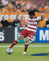 FC Dallas forward Carlos Ruiz passes the ball during the second leg of the Western Conference Semifinal Series at Robertson Stadium in Houston, TX on November 2, 2007