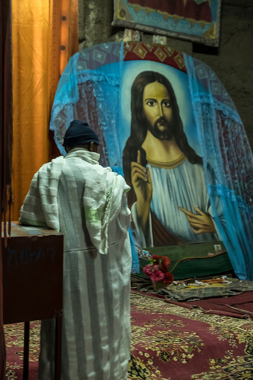 The mural of Jesus Christ is prominently displayed inside one of the rock churches in the Lalibela's northwest church cluster.