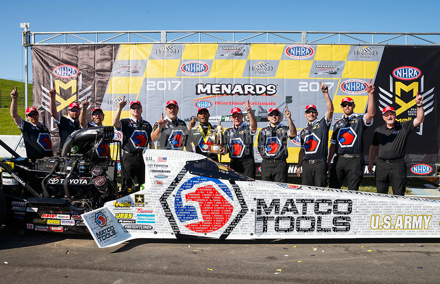 May 21, 2017; Topeka, KS, USA; NHRA top fuel driver Antron Brown celebrates with crew after winning the Heartland Nationals at Heartland Park Topeka. Mandatory Credit: Mark J. Rebilas-USA TODAY Sports