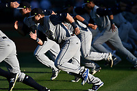 Members of the Columbia Fireflies run sprints before a game against the Greenville Drive on Wednesday, April 18, 2018, at Fluor Field at the West End in Greenville, South Carolina. Columbia won 8-4. (Tom Priddy/Four Seam Images)