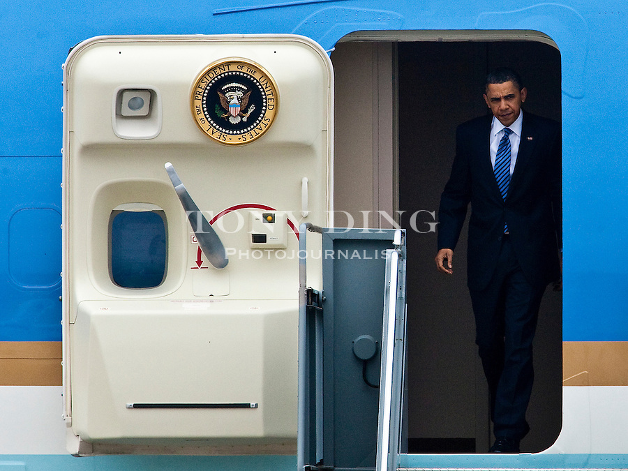 President Barack Obama appears in the doorway of Air Force One as he prepares to disembark, at Detroit Metropolitan Airport, Saturday, May 1, 2010, in Romulus, Mich. (AP Photo/Tony Ding)