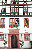 Assmannshausen, Hessen, Germany, July 2010. Traditional food with local wine in the Bauernschanke hotel and restaurant. From the vineyards in the hills around Assmannshausen one overlooks the river Rhine and its busy shipping lane, as well as the village and its church.  The fertile river valleys and the rolling hills form the basis for some of Germany's best wines.  Photo by Frits Meyst / Adventure4ever.com