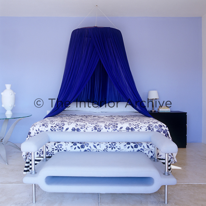In this bedroom different textures and patterns of blue have been brought together with interesting results