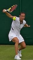 Francesca Schiavone (ITA) against Alexandra Wozniak (CAN) (23) in the frst round of the Ladies SIngles. Schiavone beat Wozniak 5-6 6-4 6-4..Tennis - Wimbledon - Day 1 - Monday 22nd June 2009 - All England Lawn Tennis Club  - Wimbledon - London - United Kingdom..Frey Images, Barry House, 20-22 Worple Road, London, SW19 4DH.Tel - +44 20 8947 0100.Cell - +44 7843 383 012
