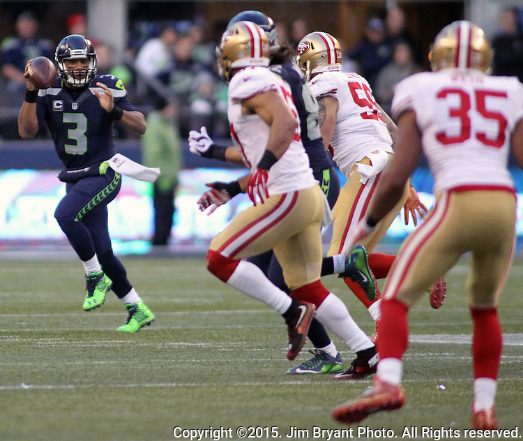 Seattle Seahawks quarterback Russell Wilson (3) looks to pass against the San Francisco 49ers at CenturyLink Field in Seattle, Washington on November 22, 2015.  The Seahawks beat the 49ers 29-13.   ©2015. Jim Bryant Photo. All RIghts Reserved.