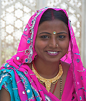 An Indian Bride visiting the Agra Fort after the wedding Agra Fort is a UNESCO World Heritage site located in Agra, India. The fort is also known as Lal Qila, Fort Rouge and Red Fort of Agra. It is about 2.5 km northwest of its much more famous sister monument, the Taj Mahal. The fort can be more accurately described as a walled palatial city...It is the most important fort in India. The great Mughals Babur, Humayun, Akbar, Jehangir, Shah Jahan and Aurangzeb lived here, and the country was governed from here. It contained the largest state treasury and mint. It was visited by foreign ambassadors, travellers and the highest dignitaries who participated in the making of history in India..