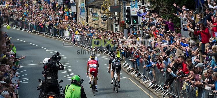 Picture by Allan McKenzie/SWpix.com -  05/07/2014 - Cycling - Tour de France 2014 Grand Depart - Stage 1, Leeds to Harrogate - Yorkshire, England - Race leaders Jens Voigt, Benoit Jarrier &amp; <br /> Nicolas Edet come through the town of Ilkley.