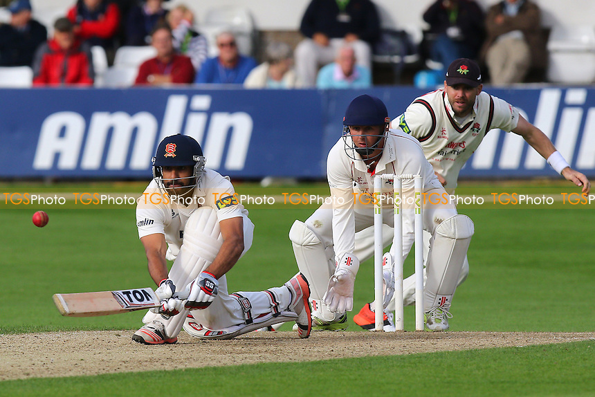 Ravi Bopara in batting action for Essex as Phil Mustard looks on from behind the stumps during Essex CCC vs Lancashire CCC, Day Two
