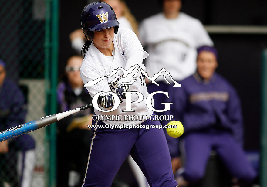 14 March 2010:  Washington Huskies all american pitcher Danielle Lawrie connects for a RBI base hit against Seattle University. Washington defeated Seattle University 8-3 at Husky Softball Stadium in Seattle, WA.