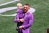 3rd February 2019, Atlanta Georgia, USA; NFL Superbowl LIII, New England Patriots versus Los Angeles Rams; Conor McGregor and his son Conor Jack McGregor Jr.on the field  prior to Super Bowl LIII