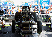 Aug. 16, 2013; Brainerd, MN, USA: The chassis for the NHRA funny car of Alexis DeJoria in the pits during qualifying for the Lucas Oil Nationals at Brainerd International Raceway. Mandatory Credit: Mark J. Rebilas-