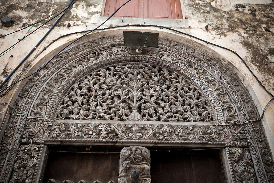 Zanzibar, Tanzania.  Carved Wooden Door, Indian Style (Rounded Top), Stone Town.