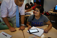 "Lindsay, California, September 5, 2012 - STeacher Adrian Gutierrez uses Kindles with his students in his Spanish I class to do course work. Principal Jaime Robles says that the school used to ban phones and and tablets, but now they embrace them. This is how students communicate and learn. So we are using the tools that they use to keep them engaged.""..Lindsay High School began building a competency-based education model about 7 years ago, fully implementing it just over three years ago and is set to graduate its first class this school year. This model does away with traditional grading and pass/fail for grades. Instead students are expected to achieve proficiency in a range of areas in each class, where a 3 (equal to a traditional B) is passing; A 4 is considered intensive and usually denotes college bound. Says Principal Jaime Robles, ?This allows students to learn at there own pace. If a student is advanced, they can move ahead, and if a student is lagging, they get the support they need.? Part of this model allows for students who are more advanced dig deeper and push harder and truly move ahead of others. Because they are ahead, some spend the extra time learning more, others take concurrent classes at the nearby community college and some choose to graduate early to start their path. ?Each student has their own set of goals,? says English teacher Amalia Lopez, ?Whatever their goals are, we support them.?.Slug: DD_ CompetencyByline: Daryl Peveto / LUCEO for Education Week"