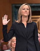 Kathleen Laura Kraninger is sworn-in to testify before the United States Senate Committee on Banking, Housing and Urban Affairs on her nomination to be Director, Bureau of Consumer Financial Protection (CFPB) on Capitol Hill in Washington, DC on Thursday, July 19, 2018.<br /> Credit: Ron Sachs / CNP