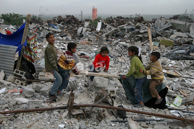 Palestinian girls play amidst the rubble next to their destroyed homes in the area of east Jebaliya, in the northern Gaza Strip, that was devastated in the last Israeli military offensive, Wednesday Jan. 29, 2009. U.S. President Barack Obama's new Mideast envoy George Mitchell sought Wednesday to strengthen a 10-day-old Gaza cease-fire that was thrown into turmoil, as Israeli warplanes pounded Gaza smuggling tunnels in retaliation for a Palestinian bombing on Tuesday that killed a soldier.  APAIMAGES PHOTO / Ashraf Amra