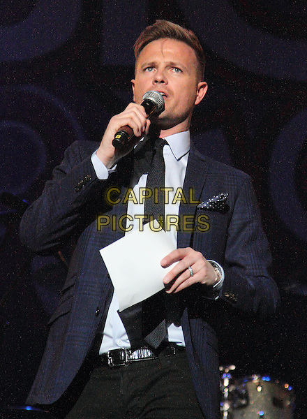Nicky Byrne<br /> at the Girlguiding Big Gig at the LG Arena, Birmingham, England, UK, June 1st 2013.<br /> half length on stage suit tie navy blue microphone <br /> CAP/JIL<br /> &copy;Jill Mayhew/Capital Pictures