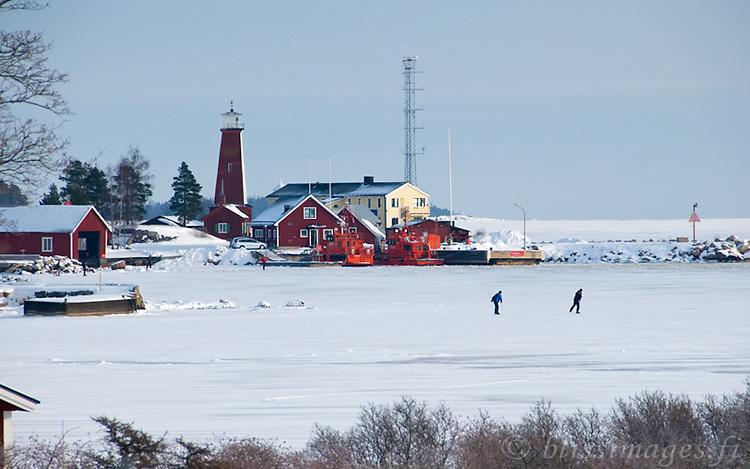 Skaters on a winter's day at Böna Lighthouse, Gävle, Sweden.