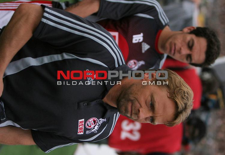 2.Liga 2007/2008  1. Spieltag Hinrunde<br /> FC St.Pauli &ndash; vs. 1.FC Koeln 0:2<br /> <br /> Techniktrainer Thomas Icke Haessler auf dem Weg zur Trainerbank des 1.FC Koelns. Hintergrund Ersatzspieler Andr&eacute; (Nr.16).<br /> <br /> <br /> Foto &copy; nph (nordphoto)<br /> <br /> *** Local Caption ***