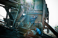 Men try to repair an old coal plant dating back from the Soviet era.