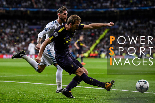 Harry Kane of Tottenham Hotspur FC (front) fights for the ball with Sergio Ramos of Real Madrid (back) during the UEFA Champions League 2017-18 match between Real Madrid and Tottenham Hotspur FC at Estadio Santiago Bernabeu on 17 October 2017 in Madrid, Spain. Photo by Diego Gonzalez / Power Sport Images