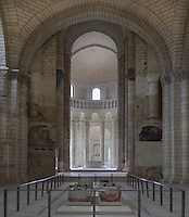 Nave and apse of the Romanesque abbey church of Fontevraud Abbey, Fontevraud-l'Abbaye, Loire Valley, Maine-et-Loire, France. The interior has large domes and pillars with carved capitals and contains the 12th century effigies of Henry II, 1133-89, Plantagenet King of England and his wife, Eleanor of Aquitaine 1122-1204, the tomb of King Richard I the Lionheart (reigned 1189-99), and tombs of Isabelle, wife of King John I. The abbey itself was founded in 1100 by Robert of Arbrissel, who created the Order of Fontevraud. It was a double monastery for monks and nuns, run by an abbess. Picture by Manuel Cohen