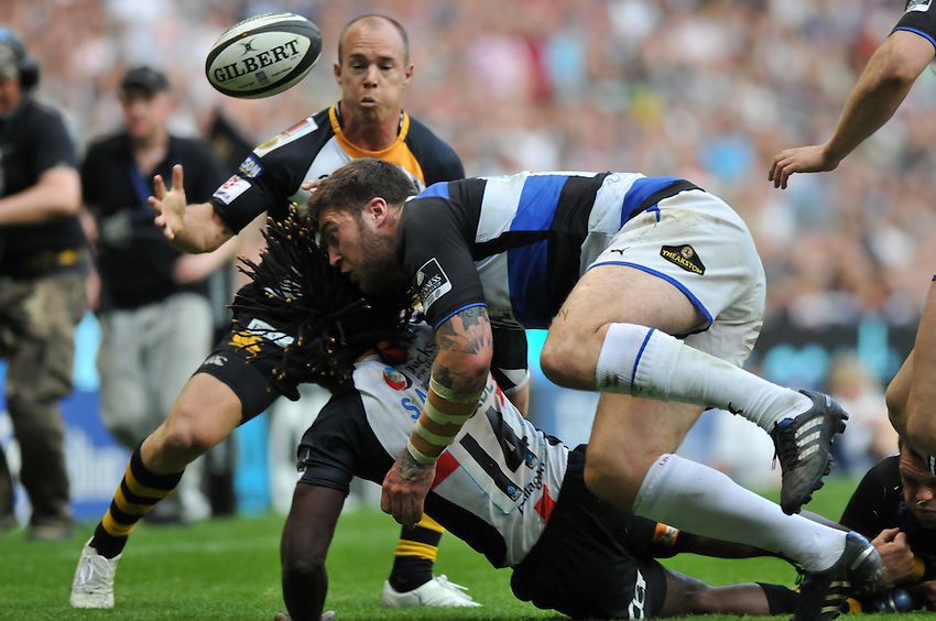 Photo: Tony Oudot/Richard Lane Photography. London Wasps v Bath Rugby. The St. George's Day Game. Guinness Premiership. 24/04/2010. .Matt Banahan of Bath clatters Wasps' Paul Sackey to the ground.