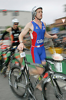 02 SEP 2007 - HAMBURG, GER - Christopher Stuart (GBR) races back into transition after the bike leg - World Age Group Triathlon Championships. (PHOTO (C) NIGEL FARROW)