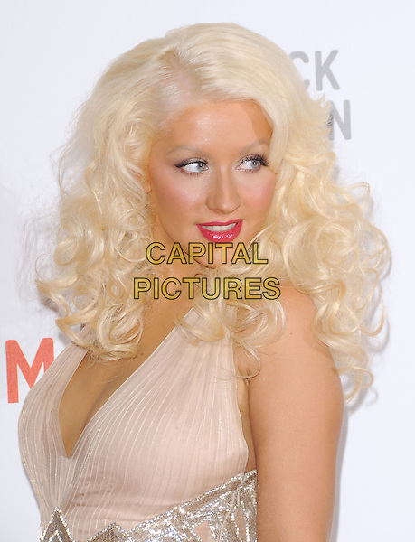 "CHRISTINA AGUILERA .at LACMA's ""The Unmasking"" The Lynda & Stewart Resnick Exhibition Pavilion Opening Gala at The Los Angeles County Museum of Art in Los Angeles, California, USA, September 25th 2010..portrait headshot make-up beauty tanned halterneck silk chiffon pink nude beige lipstick                                                                .CAP/RKE/DVS.©DVS/RockinExposures/Capital Pictures."