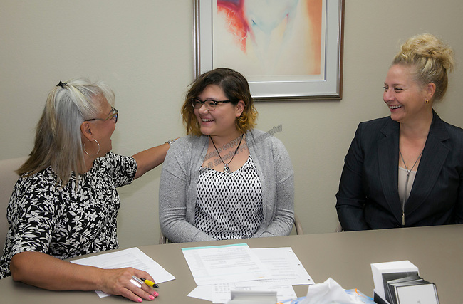 Gabriela Cortes Canchola, center, listens as President & Ceo Isabelle Rodriguez Wilson, left, and Board Member Tricia Gallenbeck explain the details and amount of her scholarship during the Nevada Women's Fund Scholarship distribution, June 20, 2019.