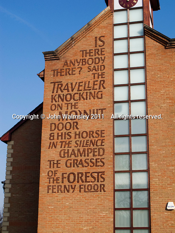 "The first verse from the poem ""The Listeners"" by Walter De la Mare on a Travel Lodge, Guildford, Surrey."
