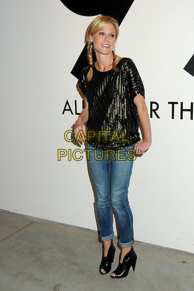 Julie Bowen.All In For The 99 Percent Event hosted by Van Jones, Rebuild The Dream and MoveOn.org held at 400 S La Brea, Los Angeles, California, USA, .31st March 2012..full length jeans top boots open toe hand in pocket  pigtails plaits hair braids  black gold  sequined sequin .CAP/ADM/BP.©Byron Purvis/AdMedia/Capital Pictures.