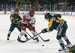 ST CHARLES, MO - MARCH 19:  Emily Clark (26) of the Wisconsin Badgers battles Jessica Gillham (7) and Savannah Harmon (14) of the Clarkson Golden Knights for the puck during the Division I Women's Ice Hockey Championship held at The Family Arena on March 19, 2017 in St Charles, Missouri. Clarkson defeated Wisconsin 3-0 to win the national championship. (Photo by Mark Buckner/NCAA Photos via Getty Images)