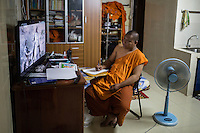 February 04, 2014 - Phnom Penh, Cambodia. Venerable Loun Sovath in his room in Samaky Raingsey Pagoda. © Nicolas Axelrod / Ruom