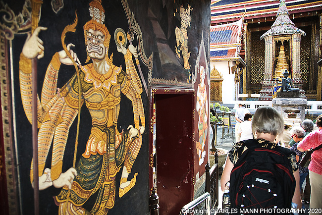 The entry to the Grand Palace and Wat Phra Kaew is a adorned with a dramatic  mural.