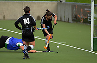 Action from the Wellington Hockey women's open grade premier two match between Karori (black) and Wainuiomata at National Hockey Stadium in Wellington, New Zealand on Sunday, 23 July 2017. Photo: Dave Lintott / lintottphoto.co.nz