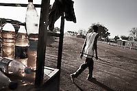 Wau, South Sudan. 19 March 2011...Resale of fuel for motorcycles in the streets of Wau, the second largest city in Southern Sudan..
