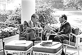 United States President Richard M. Nixon, left, meets with his National Security Advisor, Doctor Henry A. Kissinger, right, on the Colonnade outside the Oval Office in the White House in Washington, D.C. on September 16, 1972.<br /> Credit: White House via CNP