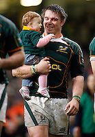 Photo: Richard Lane/Richard Lane Photography..Wales v South Africa. Prince William Cup. 24/11/2007. .South Africa captain, John Smit celebrates victory with his son.