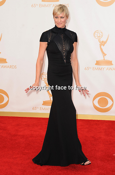 Robin Wright arrives at the 65th Primetime Emmy Awards at Nokia Theatre on Sunday Sept. 22, 2013, in Los Angeles.<br />