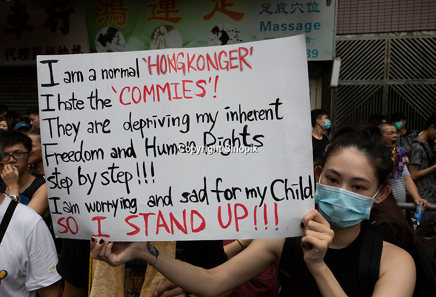 An anti-Extradition Bill protestor holds up a sign during a protest in Mong Kok, Kowloon, Hong Kong, China, 04 August 2019.