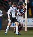 Queen of the South's Mark Durnan and Stenny's Ross McMillan clash off the ball.