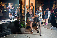 Shoppers outside the Cynthia Rowley boutique on Bleecker Street in the West Village in New York on Friday, September 10, 2010 during the second annual Fashion's Night Out event. On the first evening of New York Fashion Week stores around the city offered sales and bargains as well as parties and events to entice customers to shop. The event has been so successful in boosting sales that this year over 100 cities in the US are having their own events, and Fashion's Night Out is being planned for 16 countries. (© Richard B. Levine)
