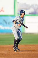 Nick Ciuffo (14) of the Princeton Rays takes his lead off of second base against the Burlington Royals at Burlington Athletic Park on July 11, 2014 in Burlington, North Carolina.  The Rays defeated the Royals 5-3.  (Brian Westerholt/Four Seam Images)